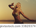 Beautiful blonde belly dancer woman 33820374