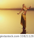 Beautiful blonde belly dancer woman 33821126