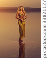 Beautiful blonde belly dancer woman 33821127