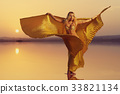 Beautiful blonde belly dancer woman 33821134