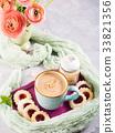 Mug of coffee cookies and flowers 33821356