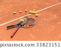 Tennis equipment on sport arena 33823151