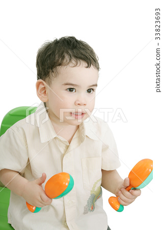 boy with maracas, isolated on white 33823693
