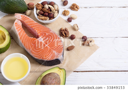 Healthy food vegetables , nuts and salmon 33849153