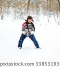 man playing snowballs 33853193