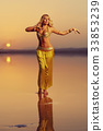 Beautiful blonde belly dancer woman 33853239