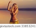Beautiful blonde belly dancer woman 33853241