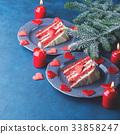 Red velvet cake slice for Valentines day dessert 33858247