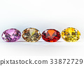 colorful gems on white background 33872729
