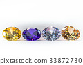 colorful gems on white background 33872730
