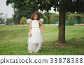beautiful girl in white dress 33878388