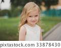 beautiful girl in white dress 33878430