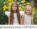 beautiful girl in white dress 33878431