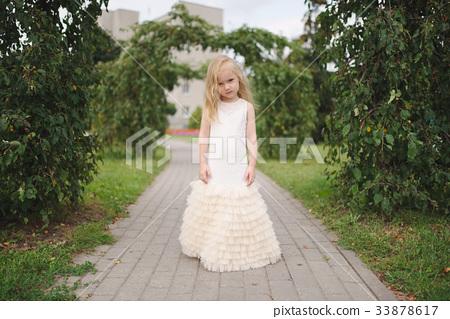 beautiful girl in white dress 33878617