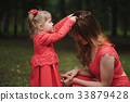little girl wears wreath mother 33879428