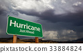 Hurricane Green Road Sign and Stormy Clouds 33884824