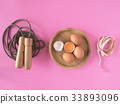 Skipping rope, eggs and tape measure  33893096
