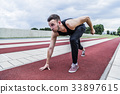 Athlete preparing for competition on running track 33897615