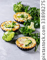 Baked quiche pie with greens 33898275