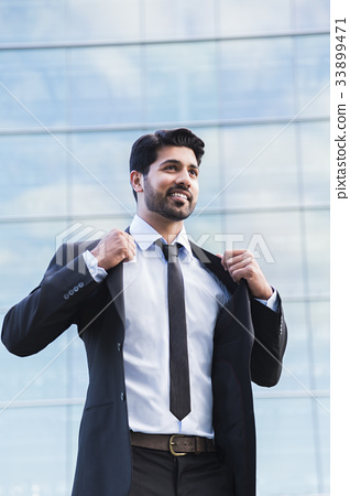 Successful businessman or worker standing in suit 33899471