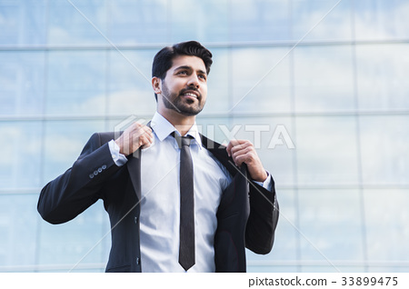 Successful businessman or worker standing in suit 33899475