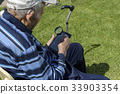 Old Man Tablet Magnifying glass Reading 33903354