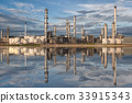 Reflection of oil refinery factory 33915343