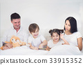 Brothers and sister read a bedtime story togather 33915352