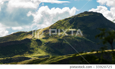 Many people hiking on mountain landscape 33920725