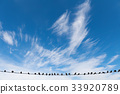 Group of Birds sitting on electric wires 33920789