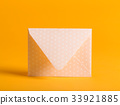 Envelope on a yellow background 33921885