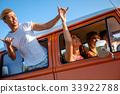 Hippie friends in a van on a road trip 33922788