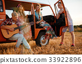 Hippie friends with guitar on a road trip 33922896