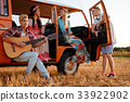 Hippie friends with guitar on a road trip 33922902