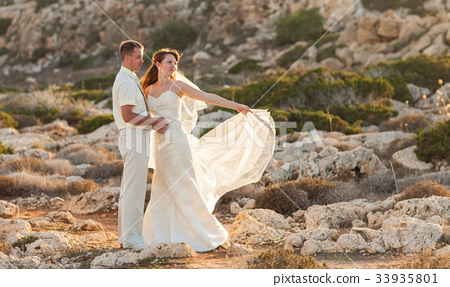 Bride and groom on their wedding day. 33935801