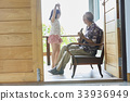 senior man is playing guitar and his granddaughter is dancing 33936949