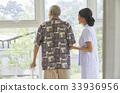 Nurse helping senior man walking with cane 33936956