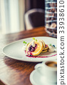 Pancakes with a cup of coffee and fresh fruits. 33938610