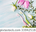 Two pastel toothbrushes with flowers herbs 33942516