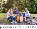 Beautiful family camping in forest, eating 33943351