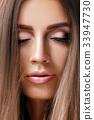 close-up of a beautiful woman with perfect make-up 33947730