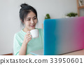 Young Asian woman using laptop computer 33950601