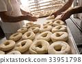 Bakers preparing dough for bagels 33951798