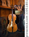 Cellos standing in luthier workshop 33951801