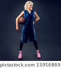 Woman basketballer in blue jersey 33956869