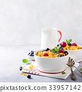 Healthy breakfast with corn flakes and berries 33957142