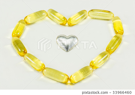 pills in heart shape and silver heart 33966460