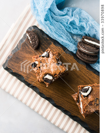 Cream cheese brownies with cookies 33970898