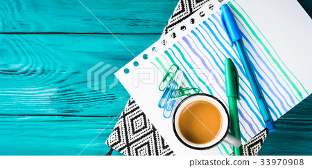 Cup of coffee, notebook and pen on dark 33970908