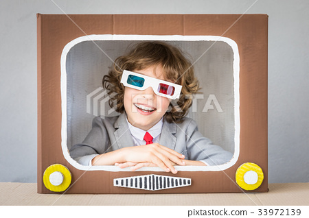 Child playing with cartoon TV 33972139